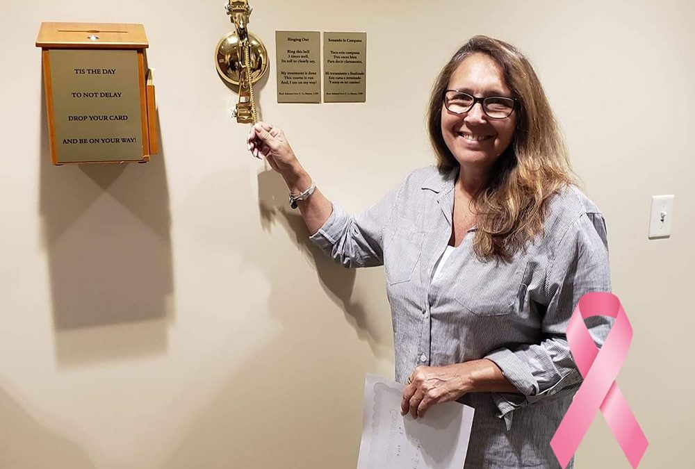 Tina Kadolph ringing the cancer-free bell